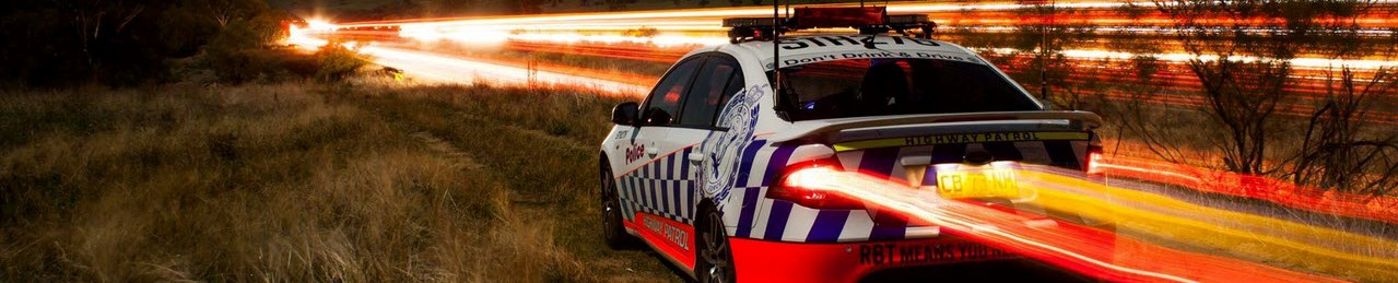 Long exposure photo of Highway Patrol car