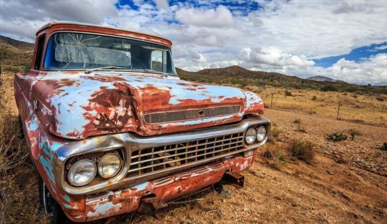 Rusty old car in desert
